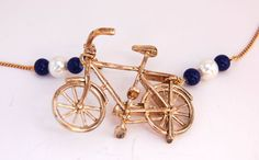 Golden bicycle charm statement necklace  Take a ride by mescouture, $16.00