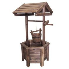 Wishing Well - I made my own plans similar to this and made 2 of these - one for me and one for my in-laws - project using cedar dog eared fence slats (Cheap)