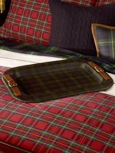 Love it all. The tartan mixes, the leather tray, and the cable knit pillows. Ralph is my favorite.