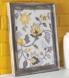 Frame your favorite fabric with a rustic, vintage frame to make easy DIY artwork for any space. | home decor