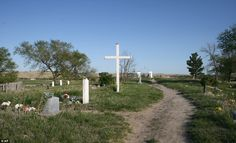 The Wounded Knee Cemetery in Wounded Knee. Some tribal members believe the area should be developed into a tourist attraction with a museum    Read more: http://www.dailymail.co.uk/news/article-2182898/In-shadow-Wounded-Knee-Inside-Pine-Ridge-reservation-South-Dakota.html#ixzz22UgLWD4c