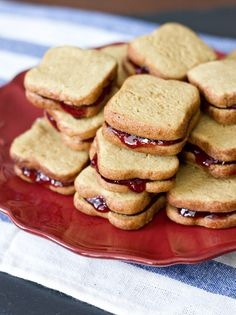 All right, these are adorable:  peanut butter cookies shaped like slices of bread, layered with jam to make tiny sandwiches.