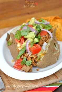 Baked Potatoes topped with taco seasoned ground turkey and all the fixings