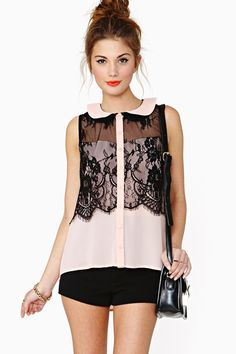 """Darkness Falls Blouse: The coolest peach blouse featuring sheer black lace detailing and a peter pan collat. Button up front. Looks amazing with a chunky ring and platform pumps! *100% Polyester *18"""" bust *23"""" length at front *27"""" length at back *Model is wearing size small *Measurements taken from size small *Hand wash cold *Imported"""