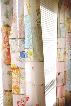 Patchwork curtains made from vintage linens.