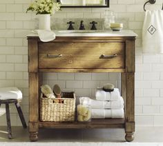 Simple bathroom vanity, but maybe with a concrete countertop?