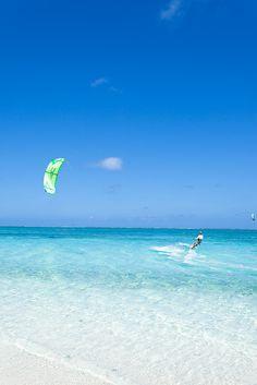 Impressively skilled kite surfers, Hatenohama Beach, the 11km long coral sand cay  Kume Island, Okinawa, Japan by ippei + janine, via Flickr