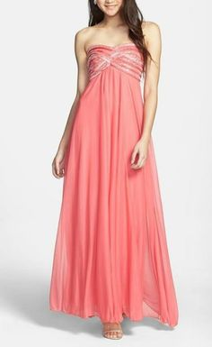 Love the sparkly detail on this strapless prom dress.