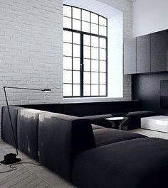 Tamizo, white brick wall, dark cabinetry