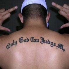 Nothing beats a cool only god can judge me tattoo across the back.