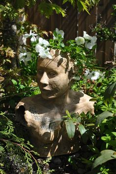 broken sculptures as garden art-different hair do every year
