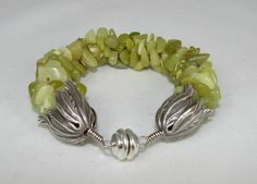 SOLD Kumihimo bracelet of olive jade chips with tulip end caps & magnetic clasp