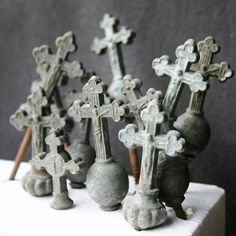 Antique oxidized crucifixes. These would be great garden objects.