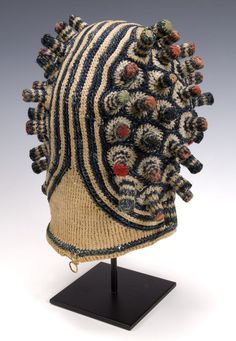 Bamileke Titleholder's Hat  Cameroon Grasslands  Early 20th century  Cotton, trade wool, wood pegs  Crochet, 10 inches high
