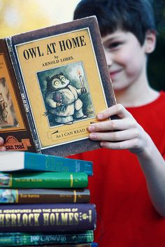 Take a photo each year with child and their favorite books