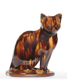 A Treacle Glaze Model of a Cat, perhaps Canney Hill Pottery, Bishop Auckland, circa 1870.