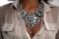 everything: the necklace,the taupe sheer, the white lace and the tan!