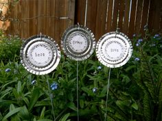 art in red wagons: metal work - Garden Markers - repurposed can lids
