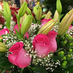 Bright Pink Roses and Lilies in bloom in our Pennsville store. #ACMEMarkets