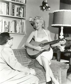 Marilyn playing guitar, I love her...