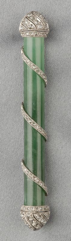Art Deco Platinum, Jade, and Diamond Brooch, the jade half cylinder with rose-cut diamond terminals and scrolls, lg. 2 3/4 in.