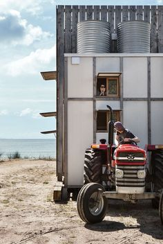As the tides erode the northern coast of New Zealand, this house on a sled can be towed off the beach and out of harm's way.