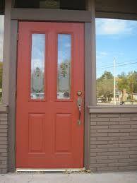 arroyo red door with painted brick