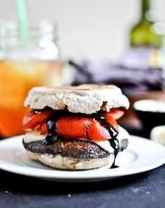 Asiago Portabella Burgers with Roasted Red Peppers & Balsamic Glaze {Via How Sweet It Is}