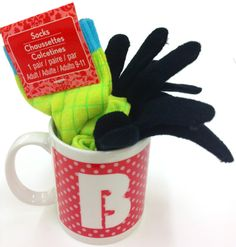 "#Gift Mug @MichaelStores   Quick, inexpensive gift idea – fill mug with socks, gloves & package of hot chocolate. Add a tag ""Sending warmth and cheer from your fingers to toes"""