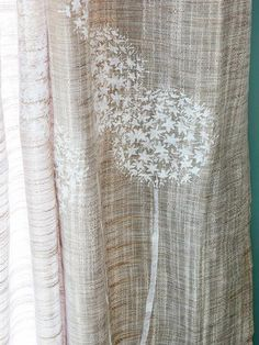 Like this idea... Subtle visual interest was added to plain linen draperies with a tone-on-tone stencil in a botanical motif. This was done using fabric paint to keep the curtains washable.