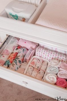 Nursery Organization dresser contents for tops drawer: swaddles, muslin blankets, burp clothes, bibs, hats and socks because you will need this the most during changes.