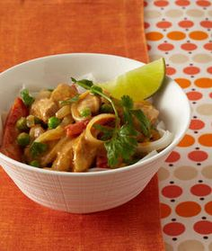 slow cooker thai chicken recipe Ingredients, 3/4c light coconut milk, 2 tbl natural creamy peanut butter, 1tbl red curry paste, 1 tsp grtd ginger, 1 1/2 p boneless chicken thighs, cut 1 1⁄2-in. pieces, 2 red bell peppers, sliced 3⁄4 in.1lg onion, sliced, 1p rice noodles, 1c frozen peas, 1/4c cilantro Lime wedges.