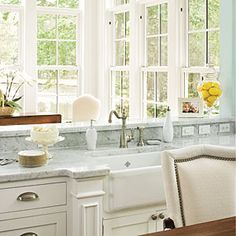 Decorate with White | A monochromatic white palette allows experimentation with texture. Layer wood, ceramics, and other materials to keep the look of white paint from falling flat. | SouthernLiving.com