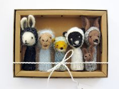 """This adorable finger puppet """"zoo"""" contains a kangaroo, fox, camel, bear and rabbit."""