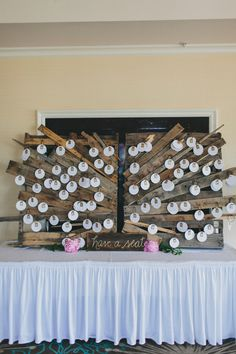 wood seating chart with pendants, photo by Rad + In Love http://ruffledblog.com/kona-kai-resort-wedding #weddingideas #seatingchart #escortcards