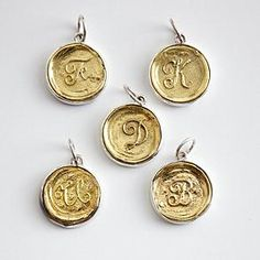 Brass Insignia Charms at Red Envelope for graduation.  Only $ 59 plus you can save 15-20% when you use Red Envelope coupons here:  http://www.coupons.com/coupon-codes/redenvelope/