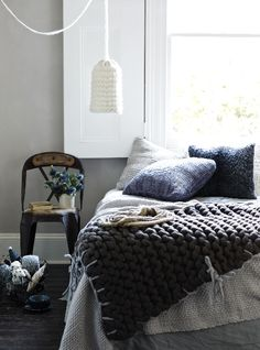 interior design, blue interiors, beds, knit blanket, bedroom lamps