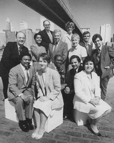 A group of City Tech alumni posing beneath the Brooklyn Bridge for a College advertisement in 1986.