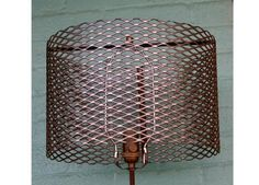 Industrial round metal lampshades made exclusively by Alice and Jay.