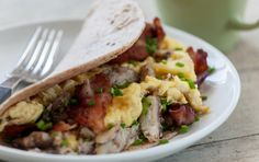 Breakfast tacos are a favored morning staple in Texas. This version is a cinch to make at home and packed with crab meat, fluffy scrambled eggs and crisp bacon. Top with salsa if you wish.