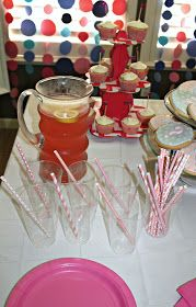Pink and blue straws and punch
