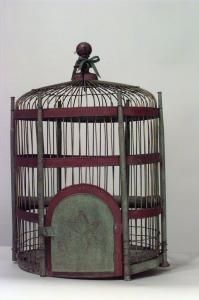 American Victorian painted green and red tole hanging bird cage with finial top.
