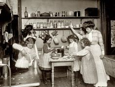 "The picture looks like it was taken in a tenement kitchen in New York, c.1910, where Mrs Hyde Kittredge's lessons in tenement housekeeping were held and from which the lessons in ""Housekeeping Notes"" have been derived."