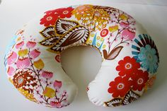 Nursing pillow cover, multicolor floral, fits Boppy and other standard pillows. $35.00, via Etsy.