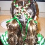 Cute hair...two braids with pig tails :)