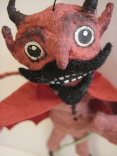 Vintage felt stuffed devil toy