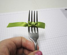 Creating the cutest little bow with a fork!  Tutorial on the Scrapbook Steals blog