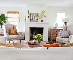 We love the white brick fireplace in this living room! More living room designs: http://www.bhg.com/rooms/living-room/room-arranging/living-room-designs/?socsrc=bhgpin061913whitebrick=1