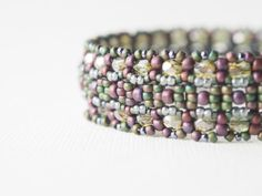 Emerald Green and Lavendar Purple Beaded Structural Bangle Bracelet. $120.00, via Etsy.