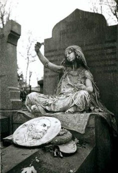 This stunning headstone is located in a graveyard in Paris, France.